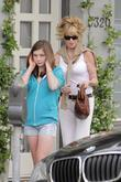 Melanie Griffith and her two daughters leaving Neil George salon in Beverly Hills