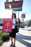 A protester stands outside a McDonalds restaurant in...