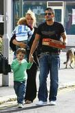 Peter Andre, with manager Claire Powell, her daughter and holding hands with a friend's son