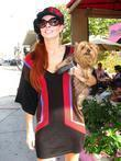 Phoebe Price out with her dog on Sunset...