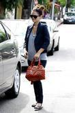 Rachel Bilson, sporting her large engagement ring, leaving a restaurant after having breakfast with a friend