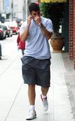 Robert Kardashian Talking On His Phone On His Way To Beverly Hills Nail Salon