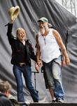Seasick Steve pulls a fan out of the...