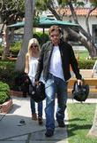 Tori Spelling and Dean Mcdermott Carrying Motorcycle Helmets At Malibu Country Mart