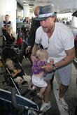 Dean McDermott arrives at Tom Bradley International Terminal at LAX airport with his daughter Stella