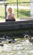 Violet Affleck Feeding The Ducks On A Park Pond In Brentwood