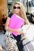 Wendy WIlliams leaving Fox studios in her lime...