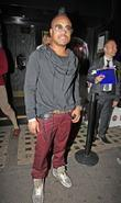 apl.de.alp of the Black Eyed Peas outside Whisky...