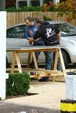 Builders Work To Erect A Fence Outside The 'x Factor' House