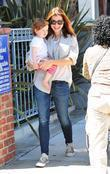 Alyson Hannigan and her daughter Satyana go shopping...