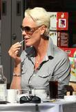 Brigitte Nielsen  applies her lipstick while enjoying...