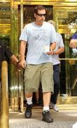 Adam Sandler leaving his hotel, carrying a cup...