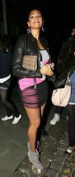 Alesha Dixon wearing a short pink mini dress...