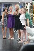 The Bachelorette star Ali Fedotowsky poses with fans...