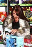 The Only Way Is Essex's Amy Childs holds...