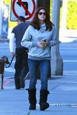 Ashley Greene takes her dog for a walk...