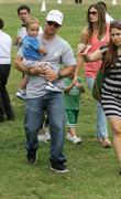 Mark Wahlberg, and his wife Rhea Durham, their children at the Elizabeth Glaser Celebrity Carnival in Santa Monica and CA