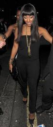 Alexandra Burke leaving Mahiki nightclub, flanked by a...