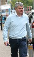 Adrian Chiles leaves the ITV studios after presenting...