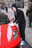 Edward Grimes aka Jedward signs autographs outside the May Fair hotel