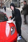 Edward Grimes aka Jedward signs autographs outside the...