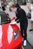 John Grimes aka Jedward signs autographs outside the...