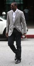 Chris Tucker seen leaving a bank while out...