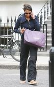 Christine Bleakley chats on her phone as she...