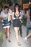 Katy Perry, Wearing A Form Fitting Black Dress, Enjoying Her Time With Friends At The 2010 Coachella Valley Music and Arts Festival - Day 1