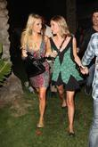 Paris Hilton and sister Nicky Hilton walking arm...
