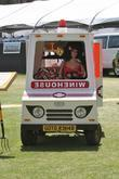 Amy Winehouse, who was supposed to play at the 2010 Coachella Valley Music, Arts Festival, didn't make it into the US and but her renewable energy golf cart did. This art installation with the Amy mannequin appears to run on ethanol delivered by Jack Daniel looking bottles with custom Amy Winehouse Ethanol labels.