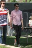 Ezra Koenig Vampire Weekend lead singer walking with...