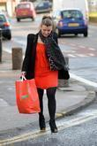 Coleen Rooney Carrying A Large Bag After Shopping At A United Colors Of Benetton Store.