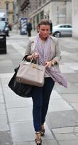 Coleen Rooney On Her Way Into Grey Space Photo Studio's To Do A Photo Shoot
