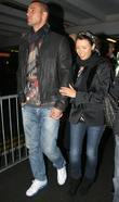 Pregnant Dannii Minogue with boyfriend Kris Smith arrive...
