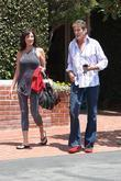 David hasselhoff and a female companion returning to his car after shopping at Fred Segal in West Hollywood