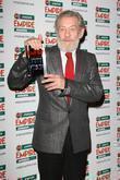Sir Ian McKellan poses with the Icon award