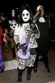 Party goer dressed as KISS band member...