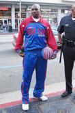 Big Easy Lofton of the Harlem Globetrotters gives...