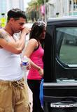 Paul DJ Pauly D DelVecchio carrying his dirty clothes on his way to a laundromat in South Beach