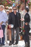 Johnny Hallyday and Laeticia Hallyday Leaving The Ivy Restaurant In West Hollywood With Their Daughters. Laeticia Is Seen Holding Birthday Balloons.