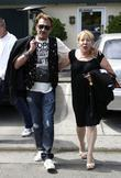 Johnny Hallyday leaves Le Petit Four restaurant on...
