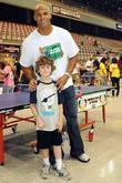 Jason Taylor with a young fan