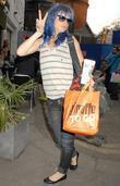 Juliette Lewis, sporting blue hair, wearing no makeup and arrives at Borderline ahead of her gig.