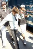 Singer Justin Bieber leaves the hotel with his...