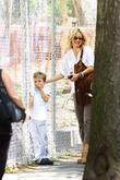 Kate Hudson checks her son Ryder Robinson's loose...