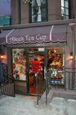 Alice's Tea Cup exterior Katie Holmes carries her...