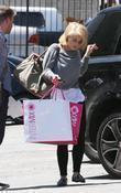 Kelly Osbourne is seen with a shopping bag...
