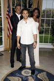 Corbin Bleu poses with the Barack and Michelle...