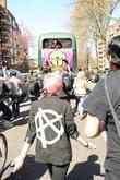 punk rockers jump on a bus during a funeral process